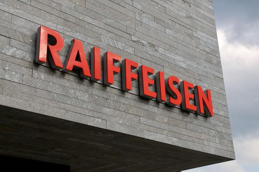 Wohlen, Aargau, Switzerland - 15th April 2021 : Swiss Raiffeisen bank sign on a concrete facade in Wohlen. Raiffeisen is a Swiss cooperative bank, the