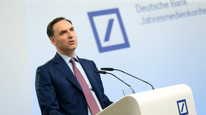 James von Moltke, CFO of Deutsche Bank AG, addresses the media during the bank's annual news conference in Frankfurt