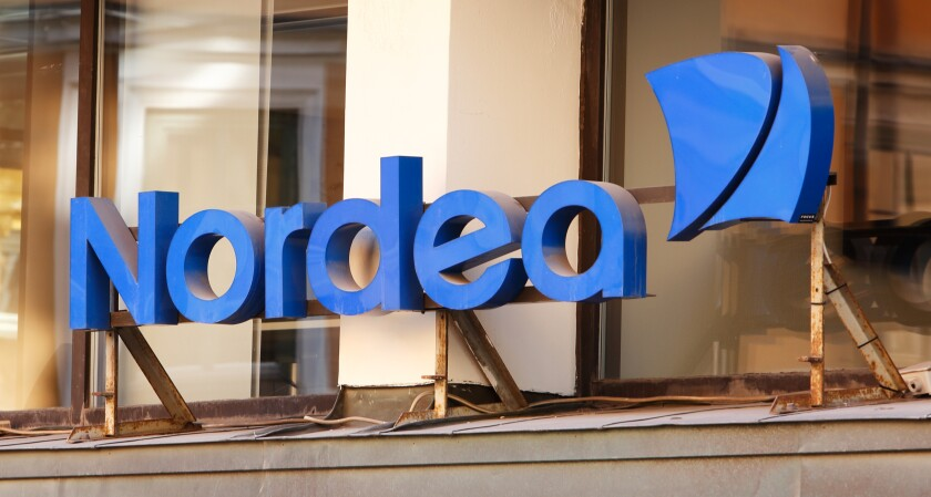 Stockholm, Sweden - August 2, 2013: Closeup of the Nordea bank office sign above the entrance at the office in downtown Stockholm.