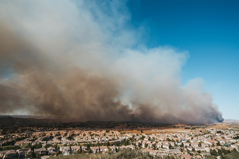 California wildfire burns near a residential area.jpg