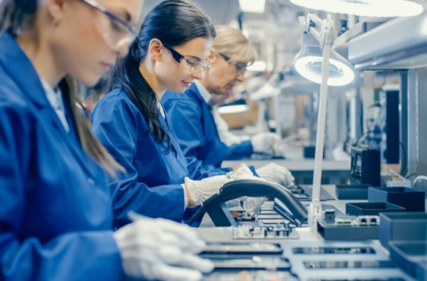 Women work factory electronics industry transition from Adobe 21Sep20 575x375