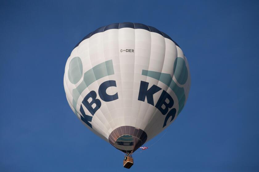 Bristol, UK. 8th August, 2015. KBC balloon lifts off at the Bristol International balloon fiesta 2015 evening Mass ascent. Credit:  Keith Larby/Alamy Live News