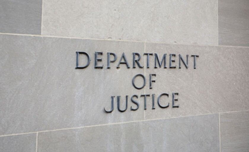 Department of Justice sign on wall.jpg