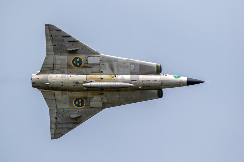 VOLKEL, NETHERLANDS - JUN 15, 2019: Vintage former Swedish Air Force Saab Draken fighter jet plane performing a fly-by at the Dutch Air Force Days.