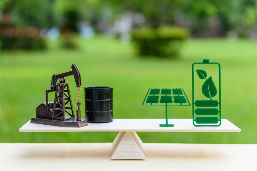 Fossil fuel vs renewable / future clean alternative energy concept : Petroleum pumpjack, crude oil drum barrel and solar panel, green battery with leaf on a simple wood balance scale in equal position