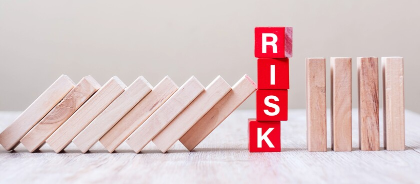 Red RISK cube blocks stop falling blocks on table. fall Business, planning, Management, Solution, Insurance and strategy Concepts