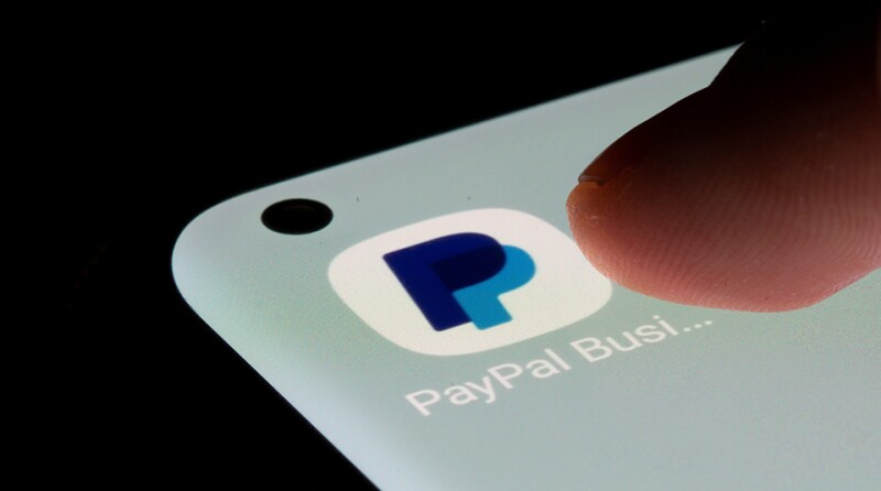 PayPal app is seen on a smartphone in this illustration taken