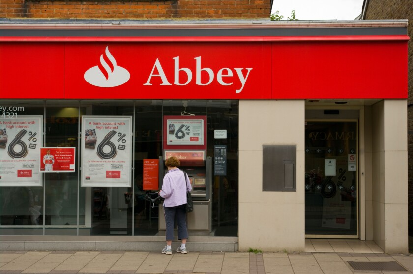 Abbey Bank Branch with a Woman at A Cashpoint