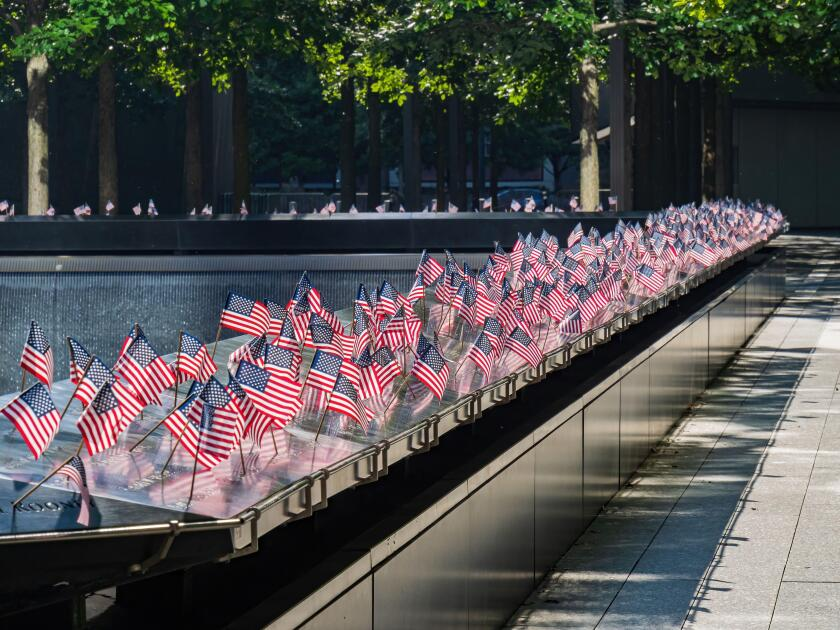 Close up shot of many America flags on the 9/11 Memorial South Pool at New York