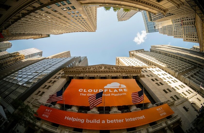 The New York Stock Exchange in Lower Manhattan in New York on Friday, September 13, 2019 is decorated with a banner for the Cloudflare initial public offering. Cloudflare provides security and support for content distribution for commercial websites. (© R
