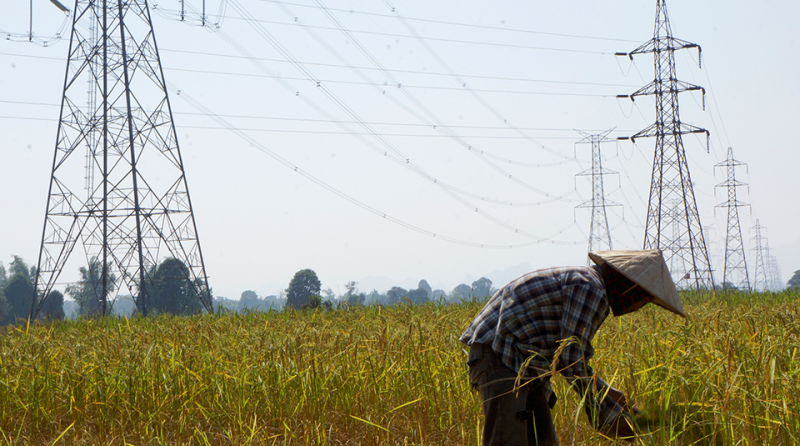 Laos-farmer-pylons-Reuters-960x535.png