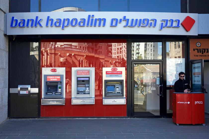 ISRAEL - JERUSALEM 18 February. Security man at guard at the entrance to Bank Hapoalim in Jerusalem on 18 February 2014. Deutsche Bank includes Israeli bank on a list of companies whose conduct is ethically questionable, possibly due to its activity in th