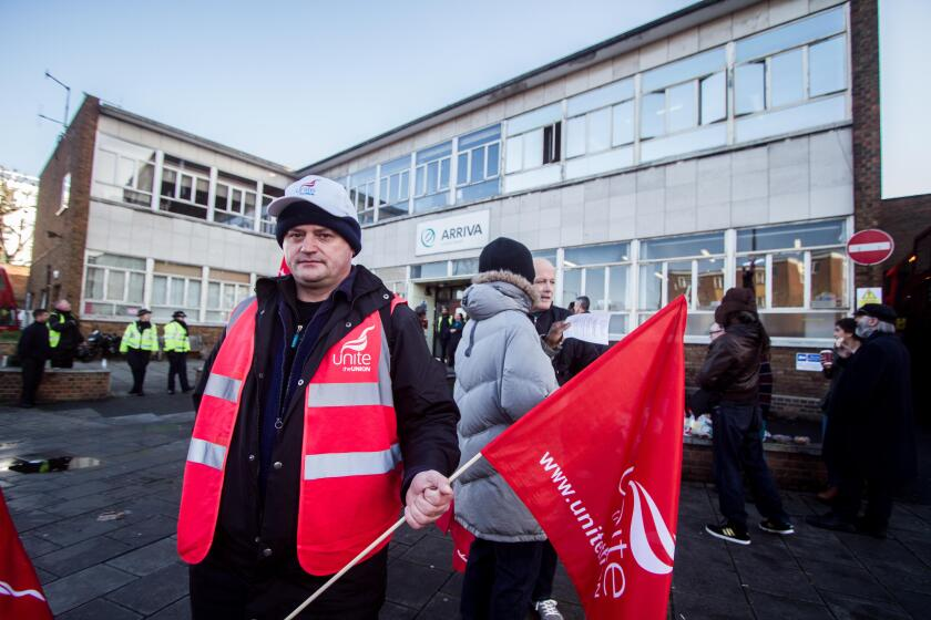 A bus Driver on strike outside Telford Avenue bus depot owned by Arriva.