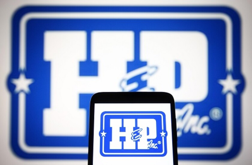 Ukraine. 13th July, 2021. In this photo illustration, Helmerich & Payne, Inc. logo is seen on a smartphone and a pc screen. Credit: Pavlo Gonchar/SOPA Images/ZUMA Wire/Alamy Live News