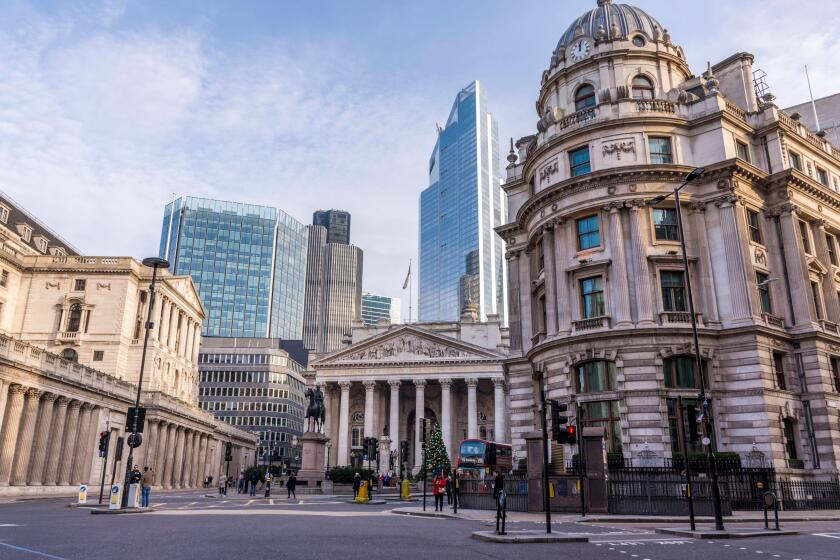 View of the London Stock Exchange, Bank of London and surrounding buildings and streets.