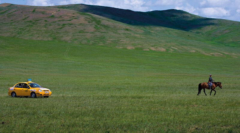 Taxi Driving through Field in Mongolia