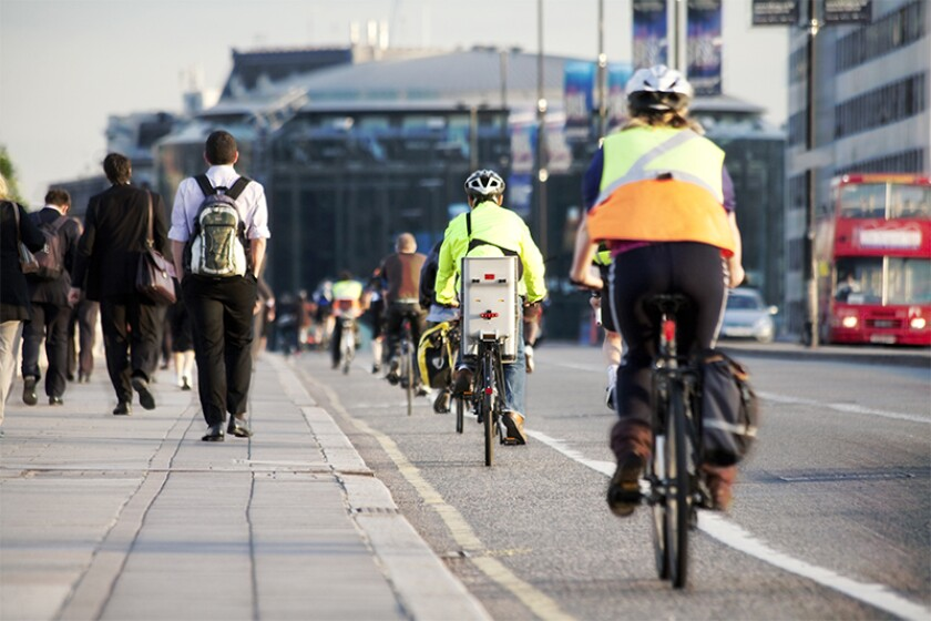 Commuters on foot and cycling over waterloo bridge.jpg