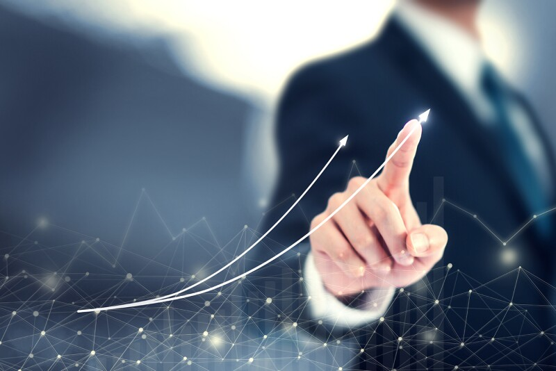Businessmen point to arrows and business growth graphs on a modern virtual interface on global network, Banking, Stock market and currency exchange.