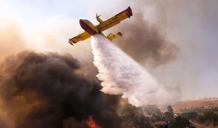 a-small-plane-makes-a-drop-on-the-wildfire-near-a-freeway-in-simi-valley-california-the-united-states-on-nov-12-2018-the-fire-in-southern-california-pa-39680012-web.jpg
