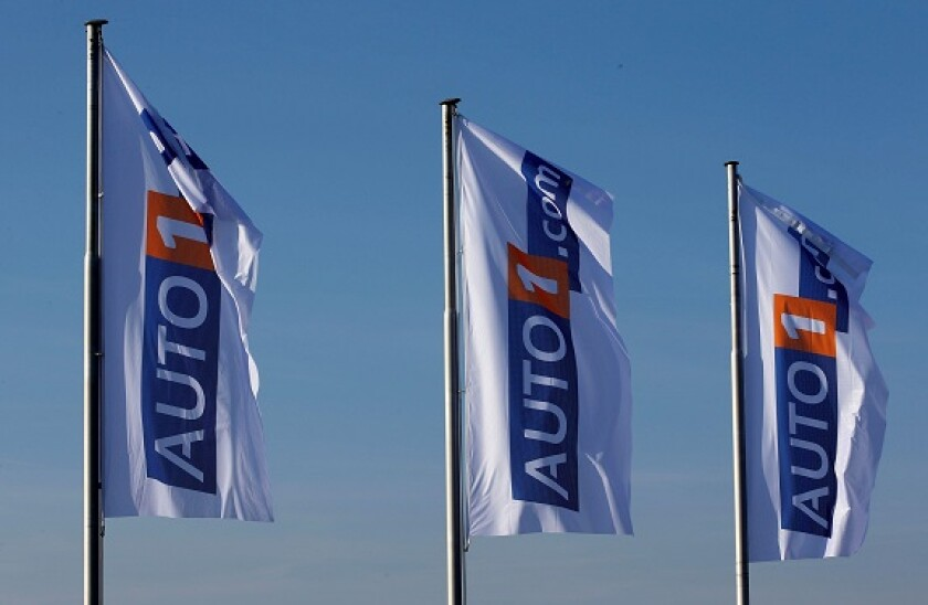 Flags with the logo of Auto1.com are pictured at the company grounds in Zoerbig, Germany January 28, 2017. Picture taken January 28, 2017. REUTERS/Fabrizio Bensch