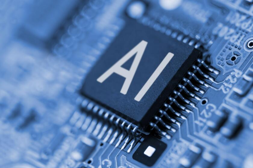 Close- up of computer chip with AI sign. Artificial intelligence.