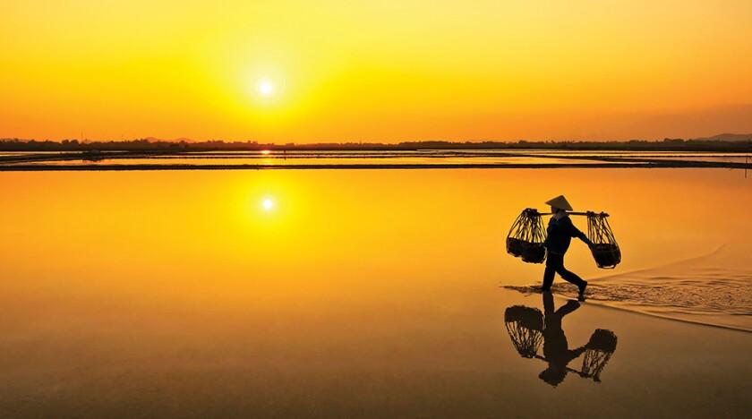 Salt farmer after wholeday working, Hon Khoi,Nha Trang,Vietnam