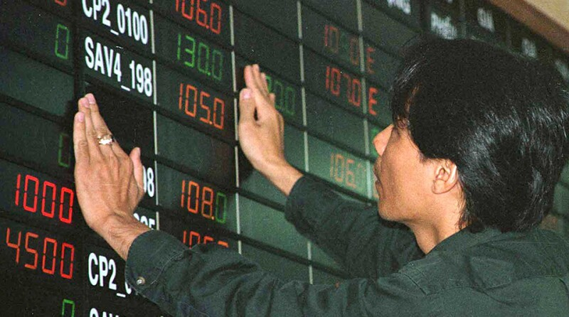 WORKER APPLIES FINISHING TOUCHES AT STOCK EXCHANGE IN HO CHI MINH CITY.