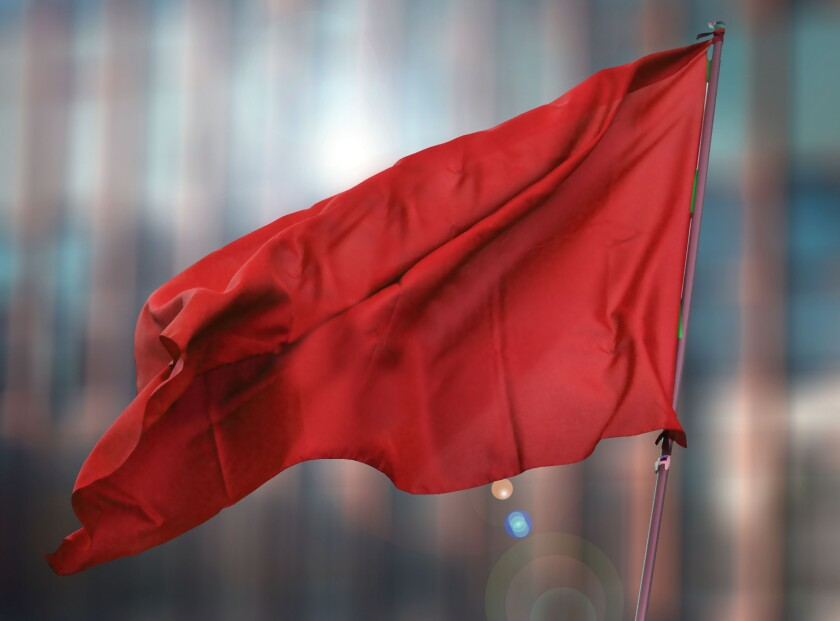red flag of the building blurred