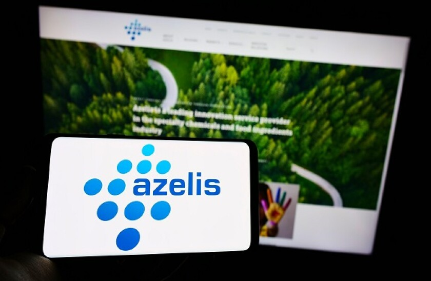 Person holding smartphone with logo of Belgian chemical company Azelis Holding S.A. on screen in front of website. Focus on phone display.