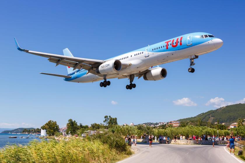 Skiathos, Greece ? July 30, 2019: TUI Boeing 757-200 airplane at Skiathos airport (JSI) in Greece.