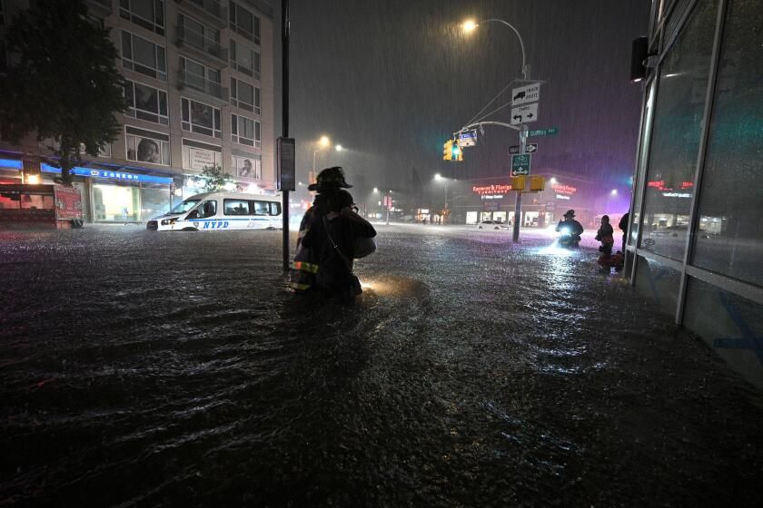 New York City, USA. 01st Sep, 2021. Members of the FDNY wade through waist high water caused by flash flooding brought by the remnants of hurricane Ida, in the New York City borough of Queens, NY, September 1, 2021. More than three inches of rain fell per