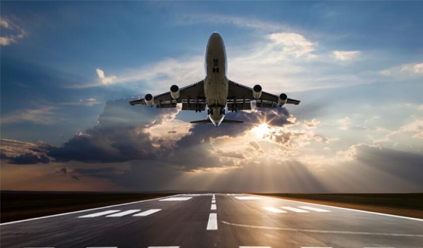 passenger-airplane-taking-off-at-sunset.jpg