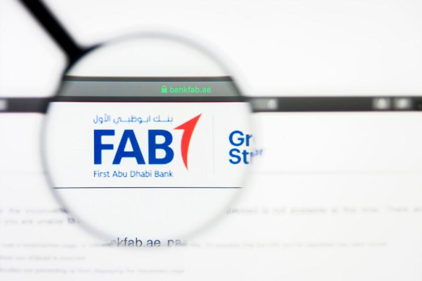 Los Angeles, California, USA - 5 April 2019: Illustrative Editorial of First Abu Dhabi Bank website homepage. First Abu Dhabi Bank logo visible on display screen.