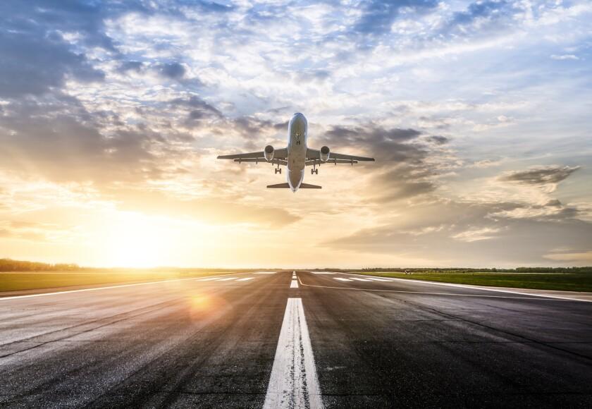 Passenger airplane taking of at sunrise