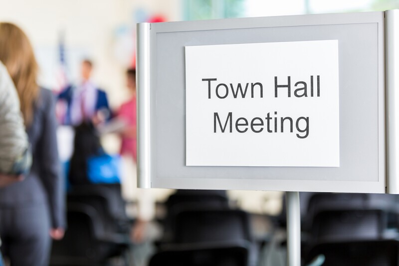 Sign directing public to town hall meeting