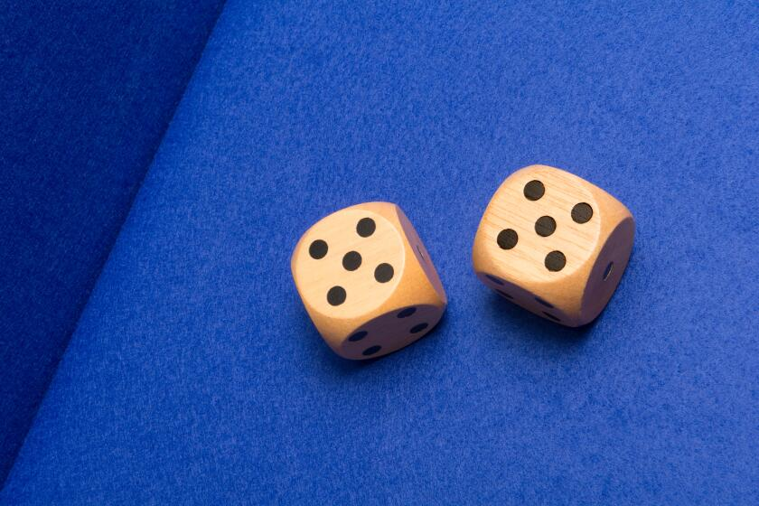Two gambling dice showing two fives