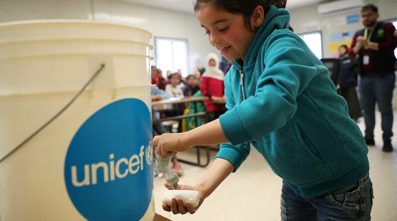 A Syrian refugee student takes part in a washing hands activity as part of an awareness campaign about coronavirus initiated by OXFAM and UNICEF at Al Zaatari refugee camp
