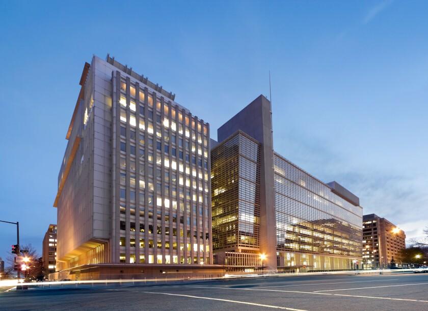 The World Bank Building headquarters main building at dusk. H Building 1818 H Street; Pennsylvania Avenue, Washington DC, USA