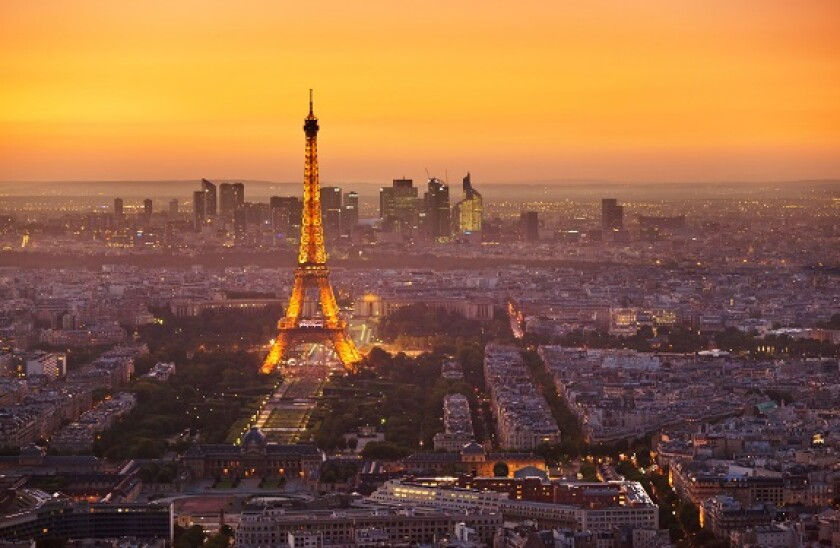 Paris skyline at sunset with the Eiffel Tower and La Defense, Paris, France, Europe