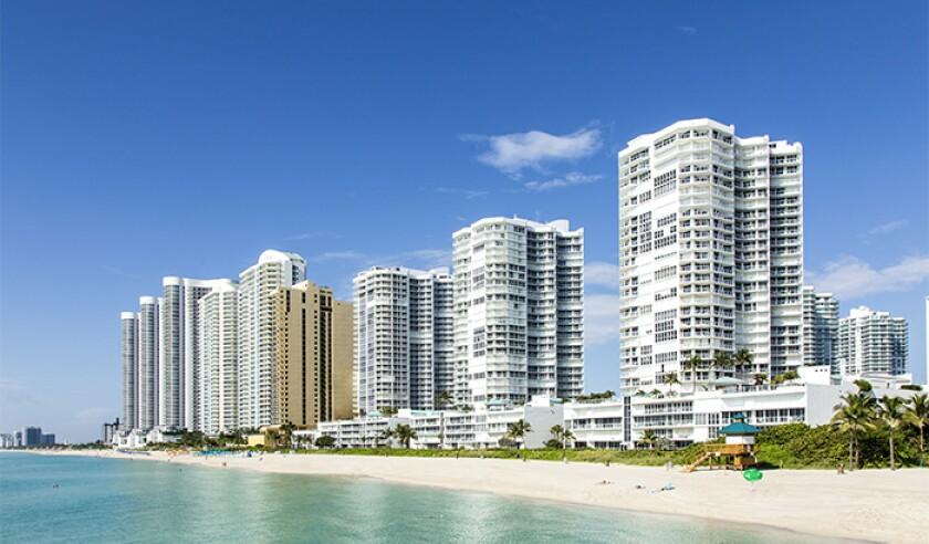 beach with condomiums skyscraper in Sunny Islands Florida.jpg