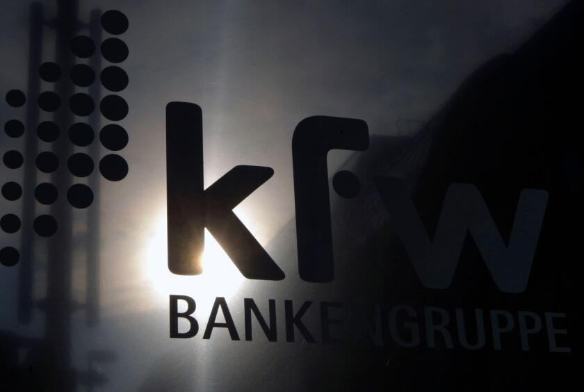The sun is reflected in the logo of the state development KfW bank in Berlin September 17, 2008. Germany's Finance Ministry wants an explanation as to why state lender KfW transferred 300 million euros ($426 million) to Lehman Brothers on the day the U.S.