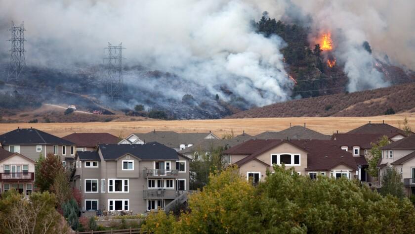 Colorado wild fire burns behind homes