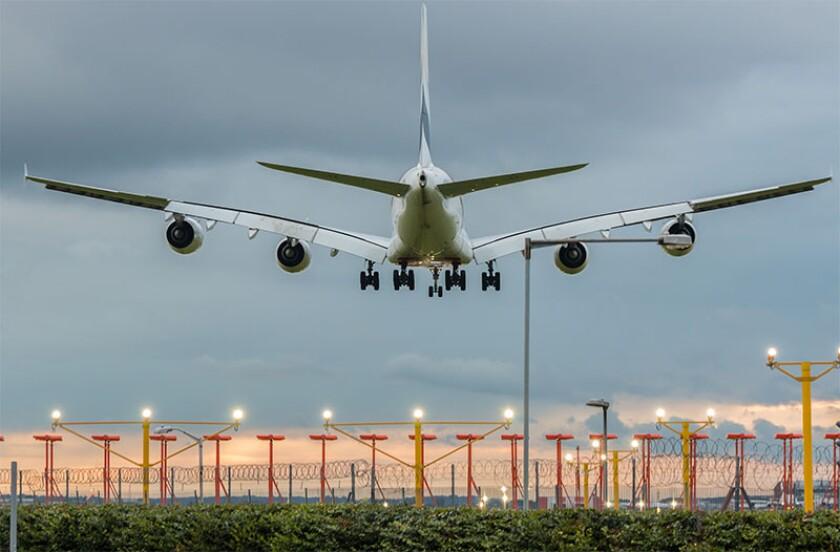 Plane landing airport evening.jpg