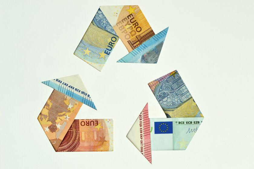 Recycle symbol made with euro banknotes - Ecology and recycling concept