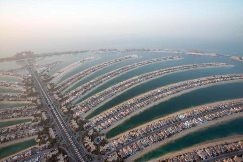 Aerial photo of The Palm Jumeirah in Dubai, UAE at dusk