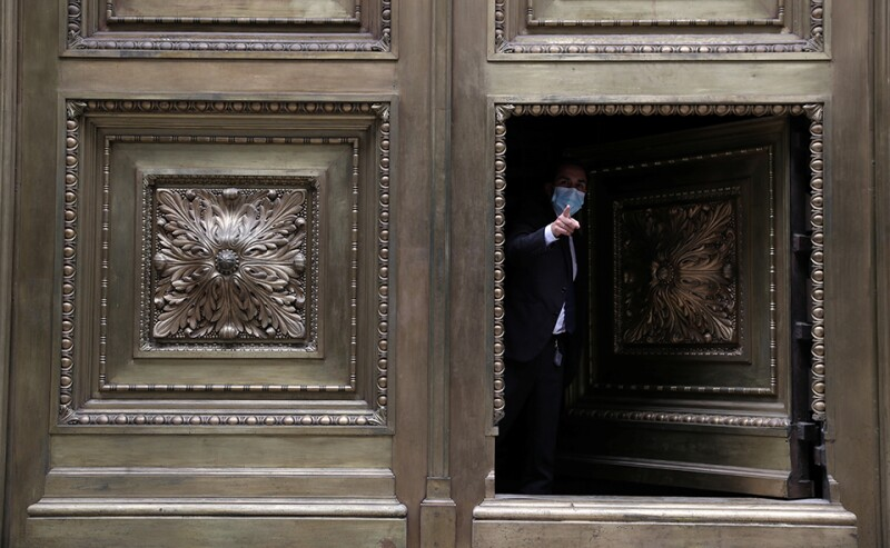 A worker at the door of the Chilean Central Bank building in downtown Santiago.