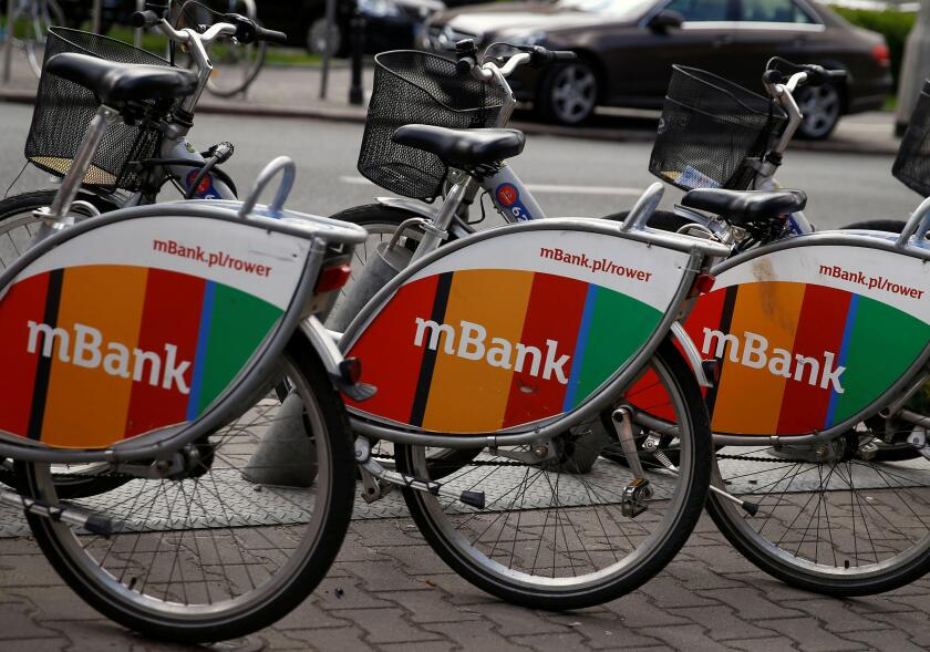 Logo of mBank, Poland's fourth-largest lender by assets, is seen as an advert on city bicycles in Warsaw, Poland April 28, 2016. REUTERS/Kacper Pempel