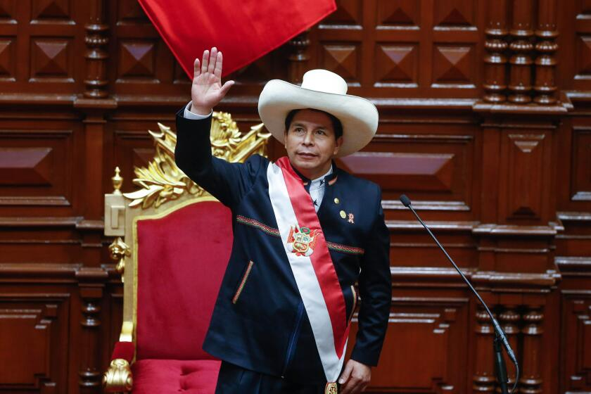 (210729) -- LIMA, July 29, 2021 (Xinhua) -- Pedro Castillo is sworn in as president of Peru during a ceremony in the nation's Congress in Lima, Peru, July 28, 2021. Pedro Castillo was sworn in on Wednesday as president of Peru during a ceremony in the nat