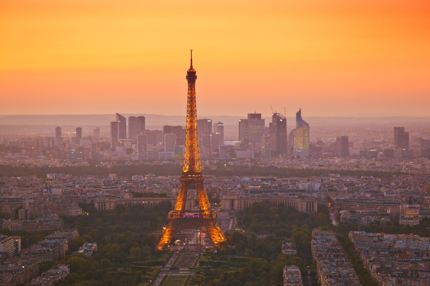 Paris skyline at sunset showing the Eiffel tower and surrounding areas Paris France EU Europe