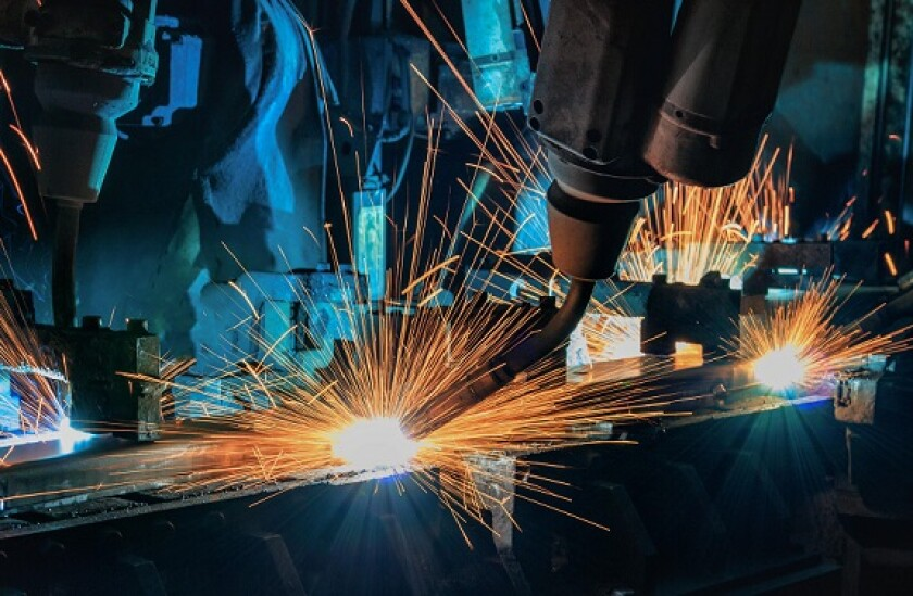 Robots welding car factory industry from Alamy 27May21 575x375